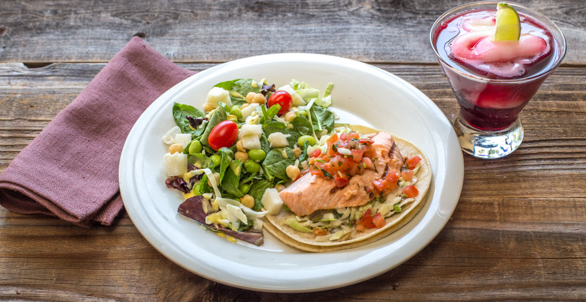 National Taco Day AND National Vodka Day. Perfect For Our...Salmon Taco Paired with our Ketel One Hibiscus Martini Swirl